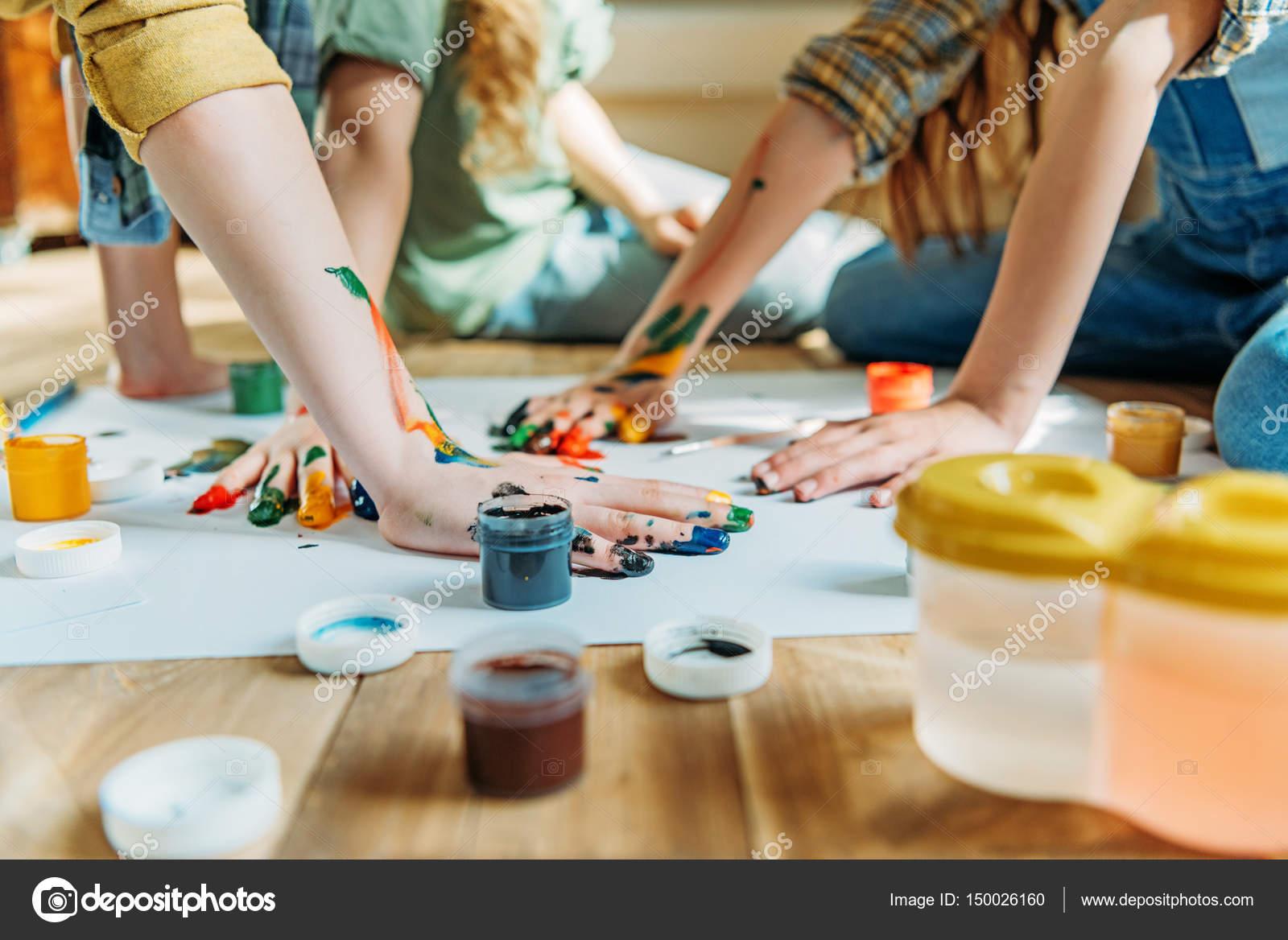 Children painting with hands stock photo - Ninos pintando con las manos ...
