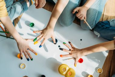 children painting with hands