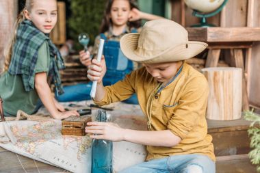 boy putting message in a bottle