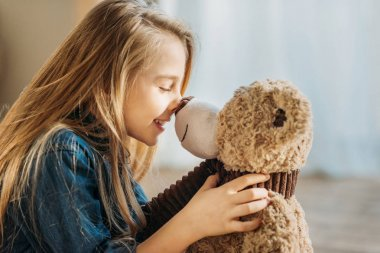 Girl with teddy bear
