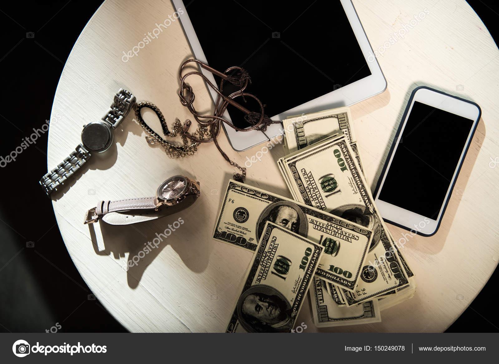 money and valuables on table — stock photo © arturverkhovetskiy