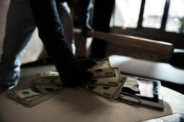 Robber stealing money