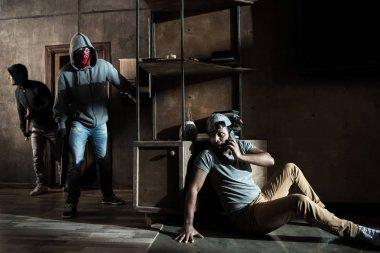 Burglars and scared man