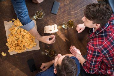 men playing jenga game