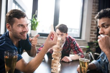 men playing jenga game