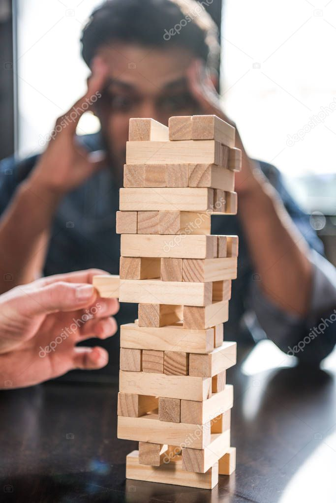 friends playing jenga game