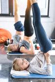 Fotografie People doing gymnastics at fitness studio