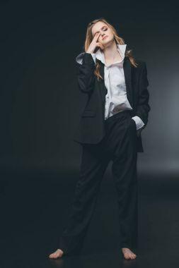 Woman posing in male costume