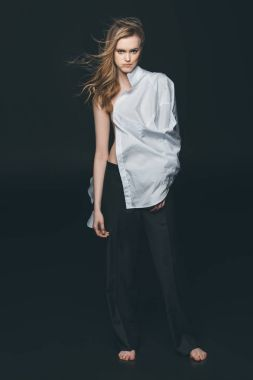 girl wearing white male shirt