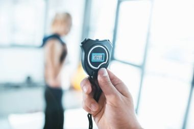 Electronic sport timer in hand, selective focus