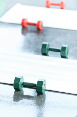 Dumbbells on floor in gum, selective focus