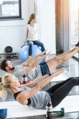 People doing gymnastics at fitness studio