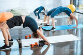 Photo People doing gymnastics, performing Bridge pose at fitness studio