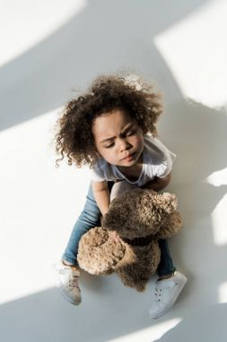 baby girl with teddy bear