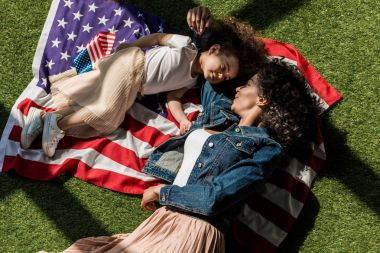 Woman with daughter on american flag