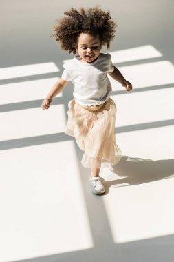 baby girl in white studio