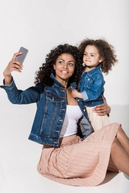 African american woman take selfie with her daughter stock vector