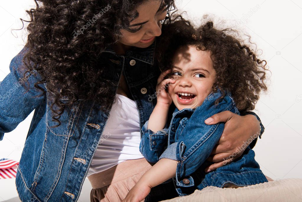 Woman with her baby girl daughter