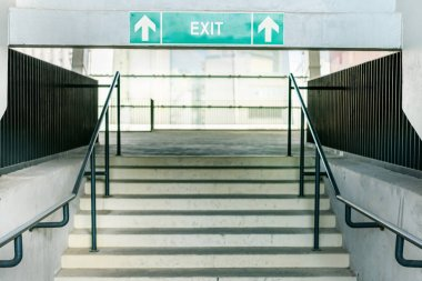 stadium stairs and exit symbol