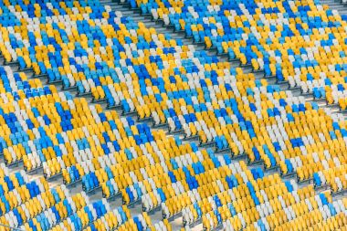 Rows of yellow and blue stadium seats and stadium stairs stock vector