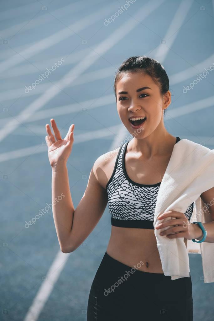 Sportswoman with towel on stadium