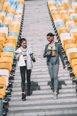 Young sportswomen on stadium