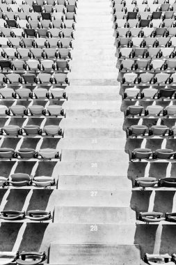 Rows of stadium seats and stadium stairs, black and white stock vector
