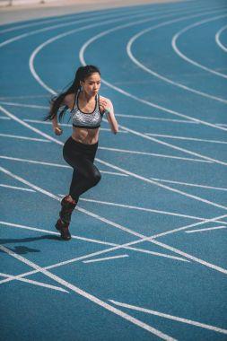 Sportswoman running on stadium