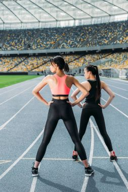 Sportswomen exercising on stadium
