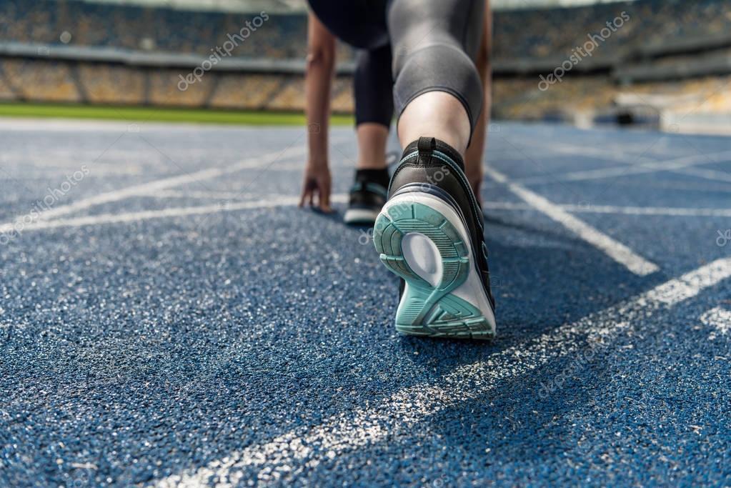 Sportswoman on starting line