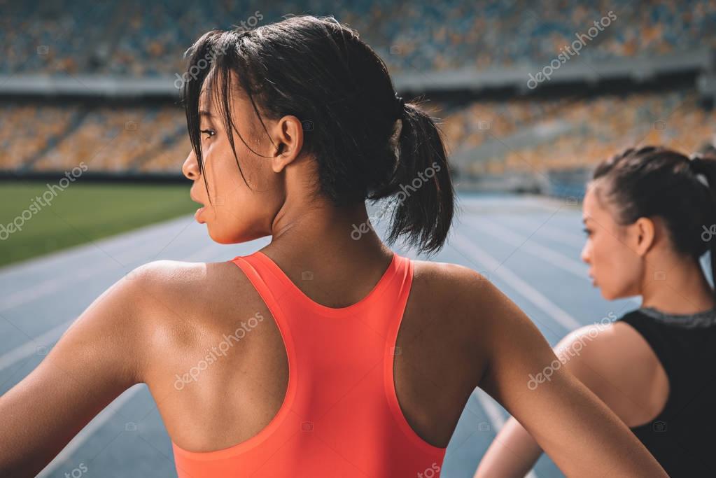 Sportswomen exercising on stadium