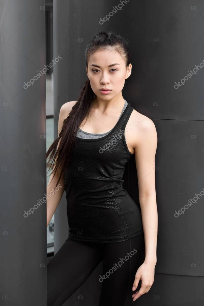 Young sportswoman posing