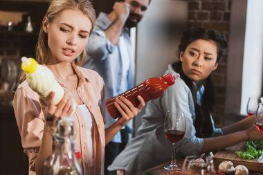 Young woman chosing sauce