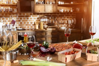 pizza, wine and vegetables ready for party