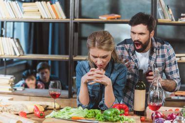Young couple quarrel, boyfriend yelling on his sad girlfriend stock vector