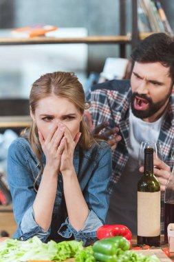 boyfriend yelling on his sad girlfriend