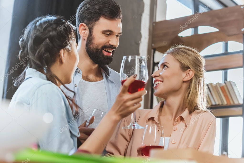 young people drinking wine