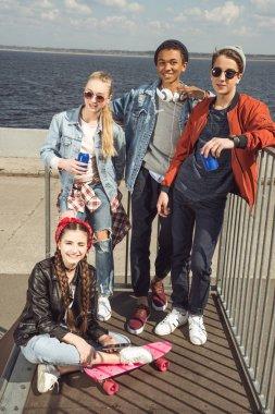 teenagers posing in skateboard park
