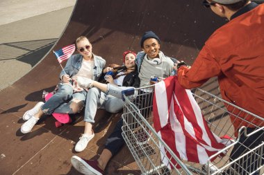 teenagers with american flag