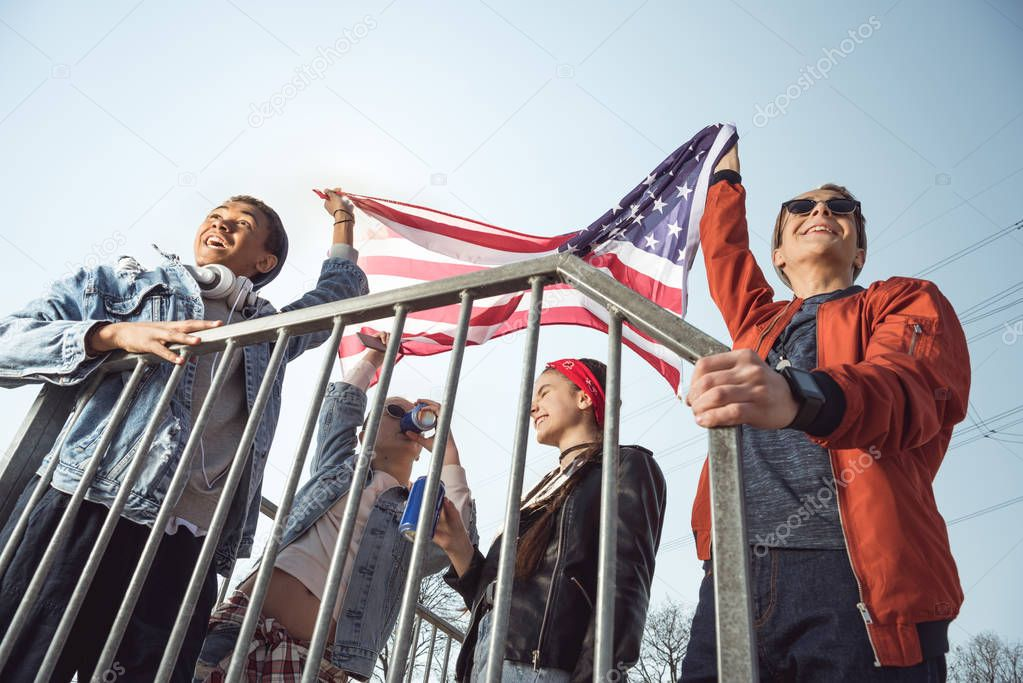 teenagers waving american flag