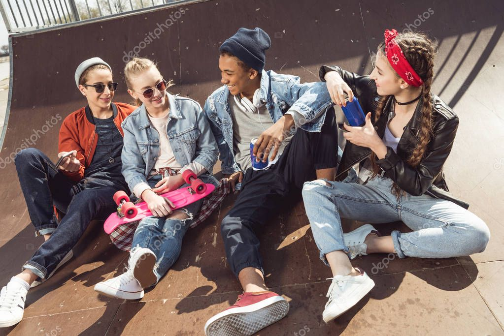 teenagers posing in skateboard park