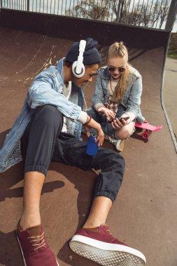 Hipster couple in skateboard park