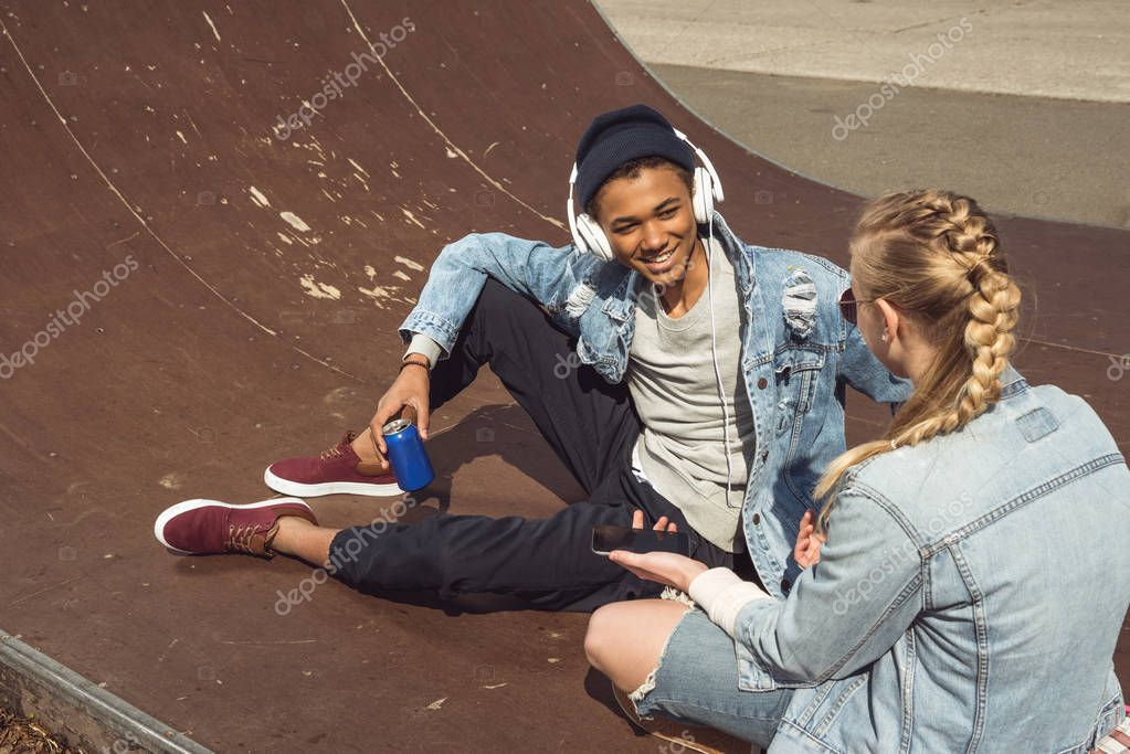 hipster couple in skateboard park