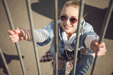 Smiling girl in skateboard park
