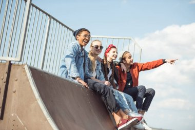 teenagers spending time at skateboard park
