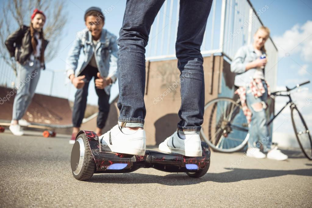 hipster boy riding gyroboard