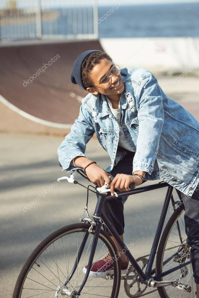 hipster boy riding bicycle