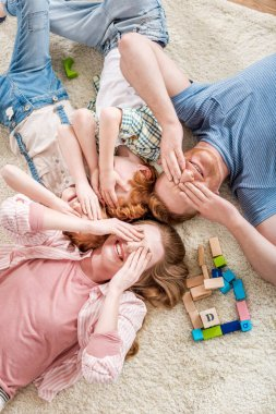 happy family lying on floor