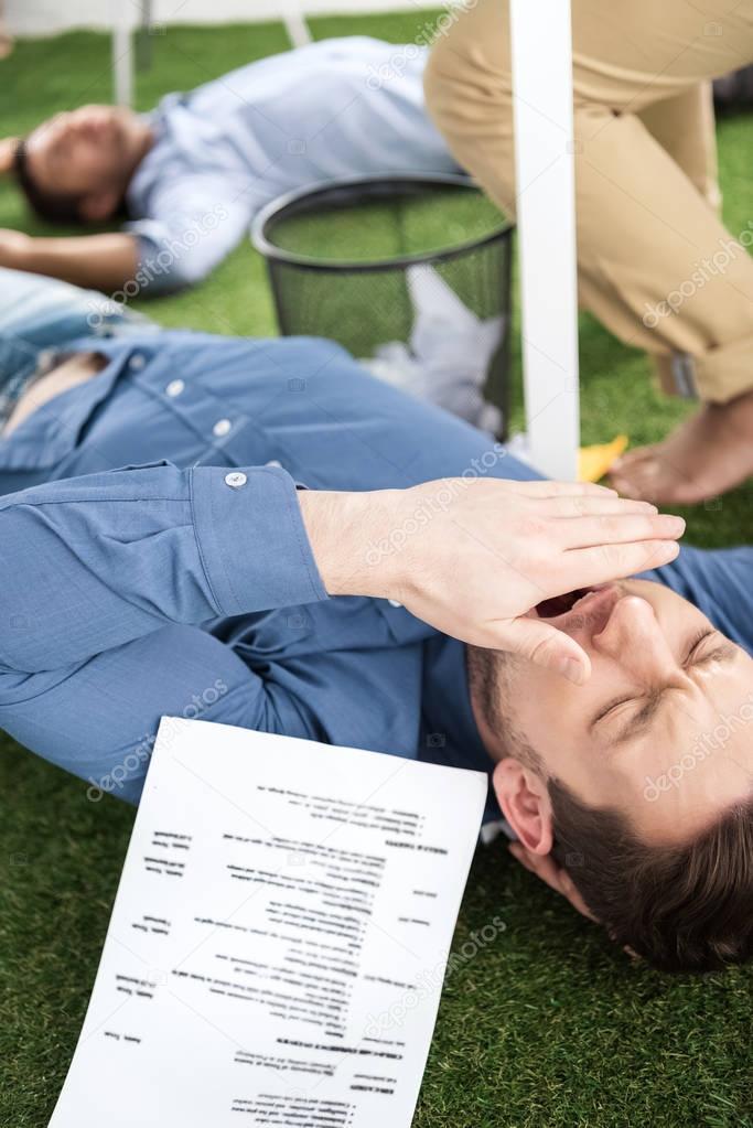 Businessmen sleeping at modern office