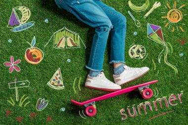 Cropped image girl on skateboard and hand drawn summer concept on grass stock vector